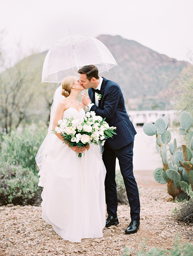 rainy day wedding portrait in the desert