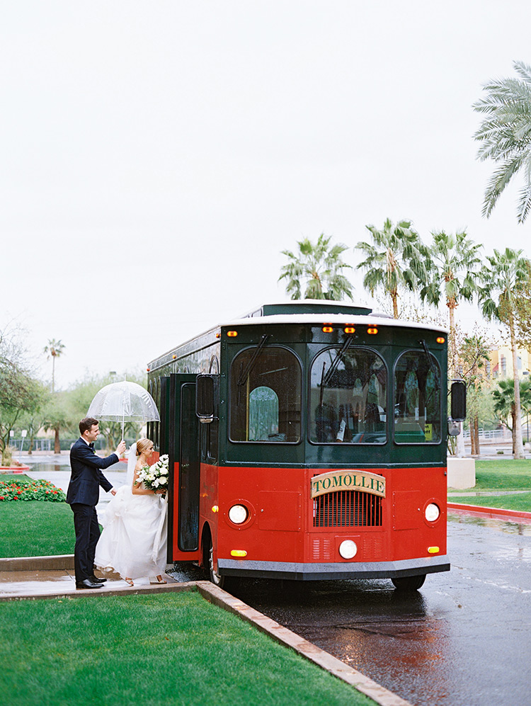 Trolley transportation on a rainy wedding day