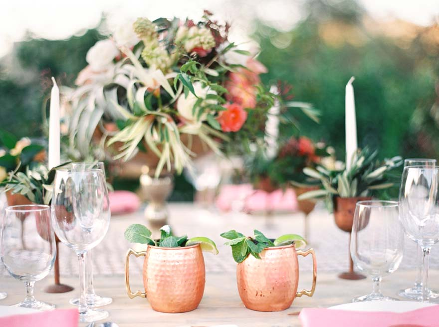 coral and copper reception table with a mix of textures