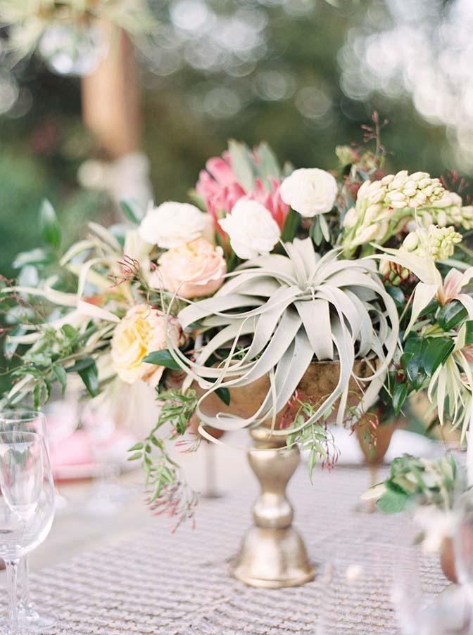 dreamy reception table, xerographica air plants, protea, copper & brass