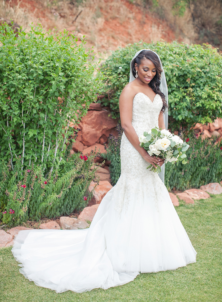 beaded lace wedding dress and white bouquet