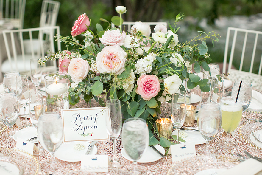 wedding reception with sequined tablecloth & pink flowers
