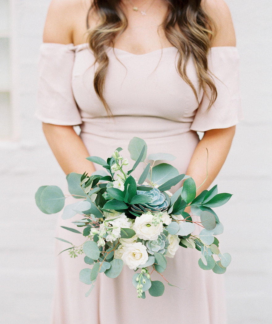 boho bridesmaid with succulents in her bouquet