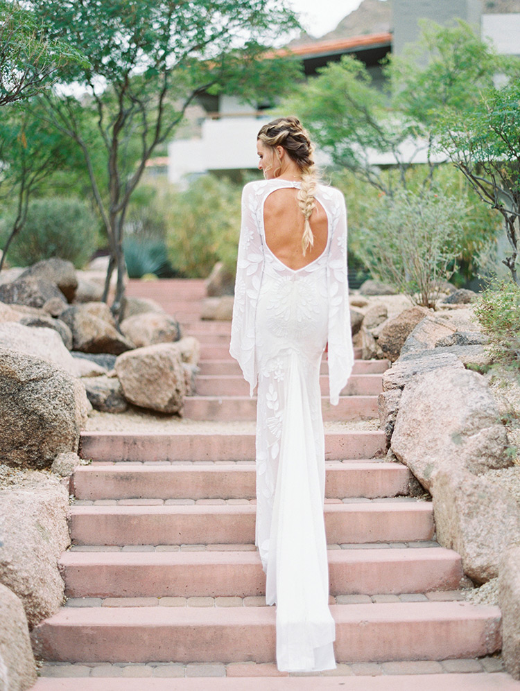 boho bride in a white-on-white embroidered dress