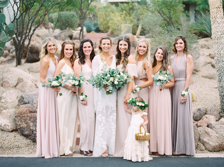 boho bridesmaids in neutrals with succulents in their bouquets