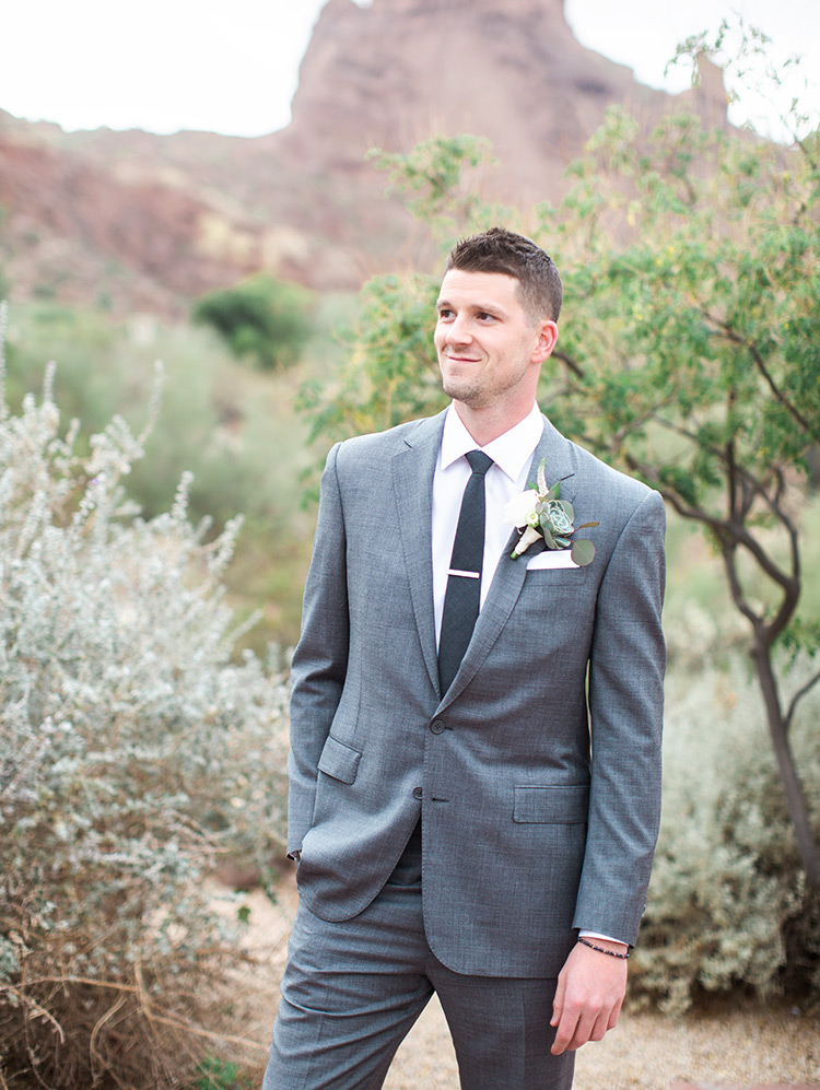 handsome groom in grey