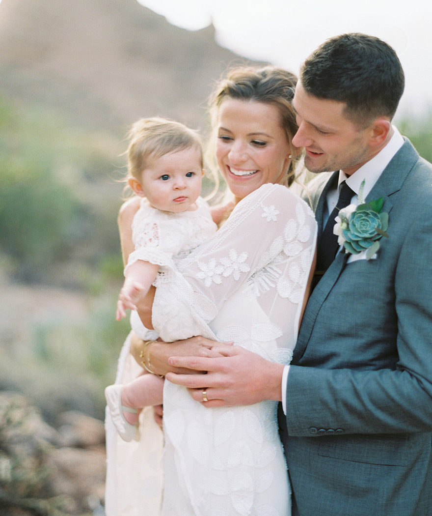 boho bride & groom with their baby