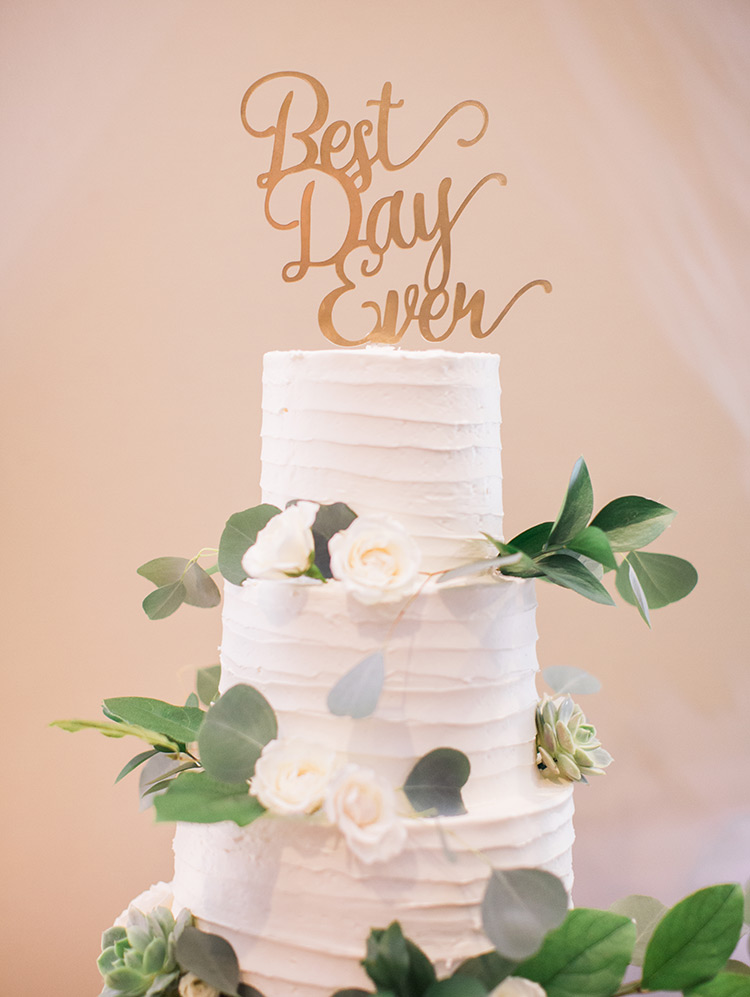 wedding cake with succulents and flowers