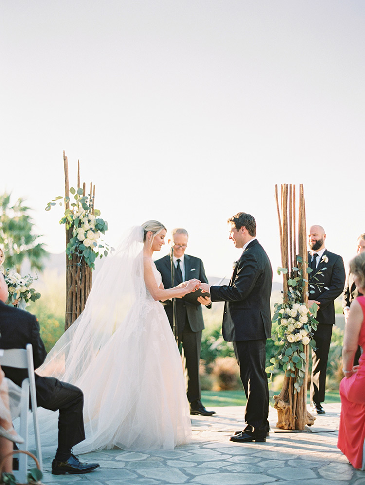 outdoor wedding ceremony with Saguaro cactus skeletons