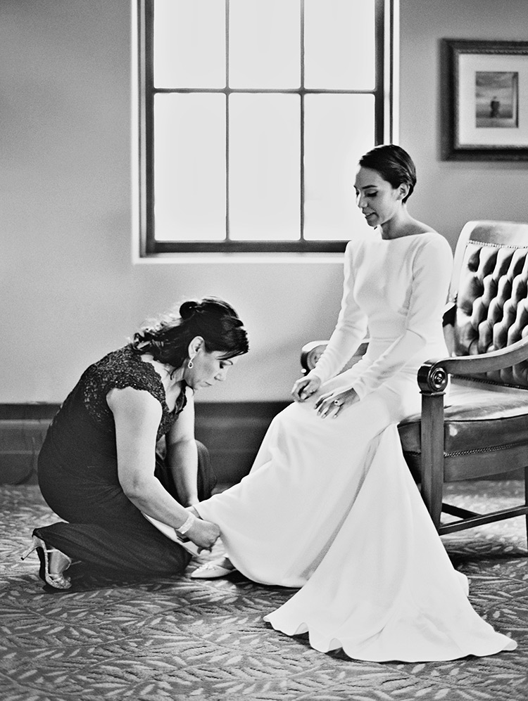 Finishing touches for the bride, minimalist wedding dress with long sleeves