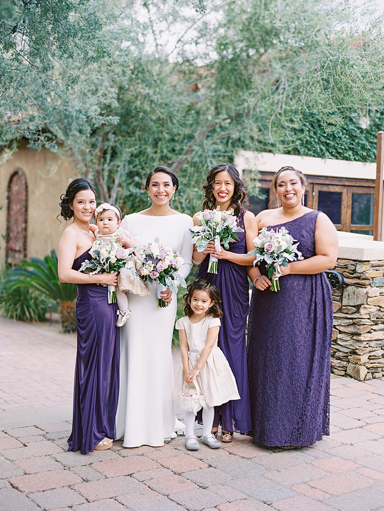 Bridesmaids in rich purple, bride with long sleeves