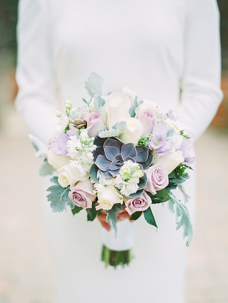 white& lavender bouquet with succulents, long sleeved wedding dress