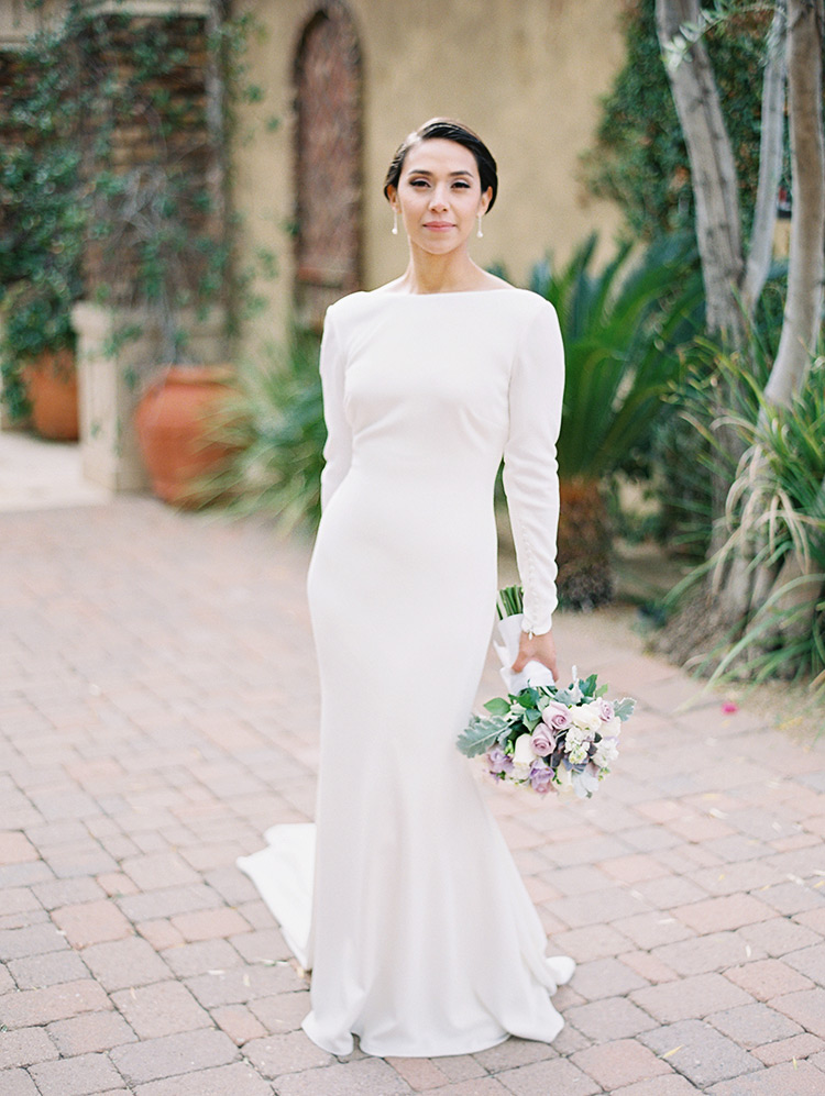 Modern bride with short hair and long sleeves, lavender bouquet