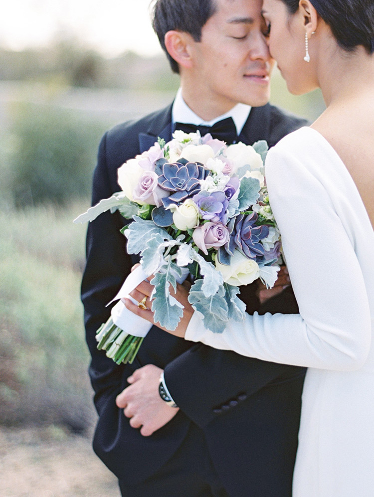 pale purple bouquet with succulents, long-sleeved wedding dress