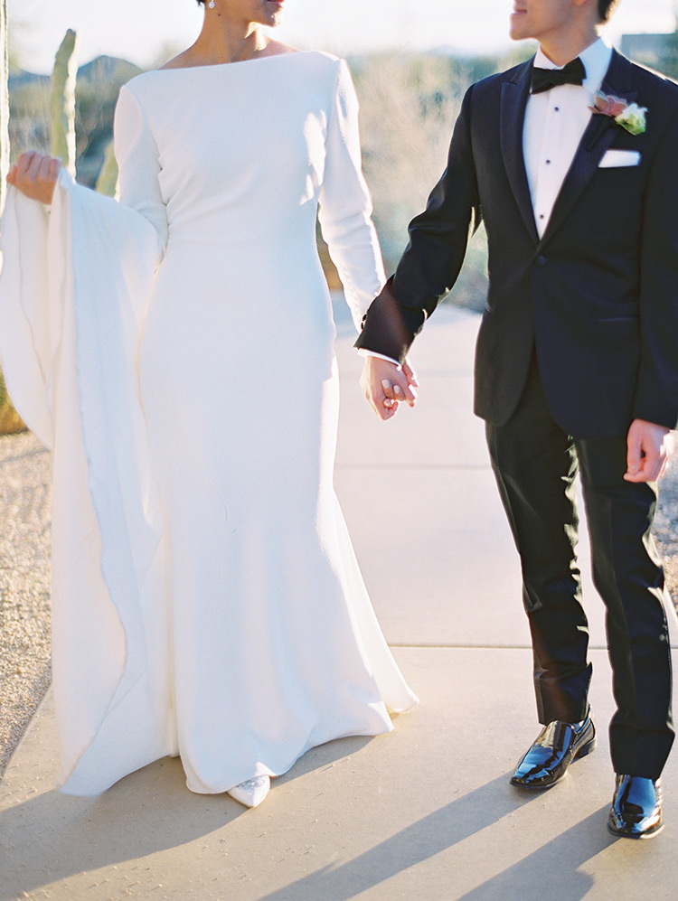 Minimalist wedding dress with long sleeves, traditional black tux