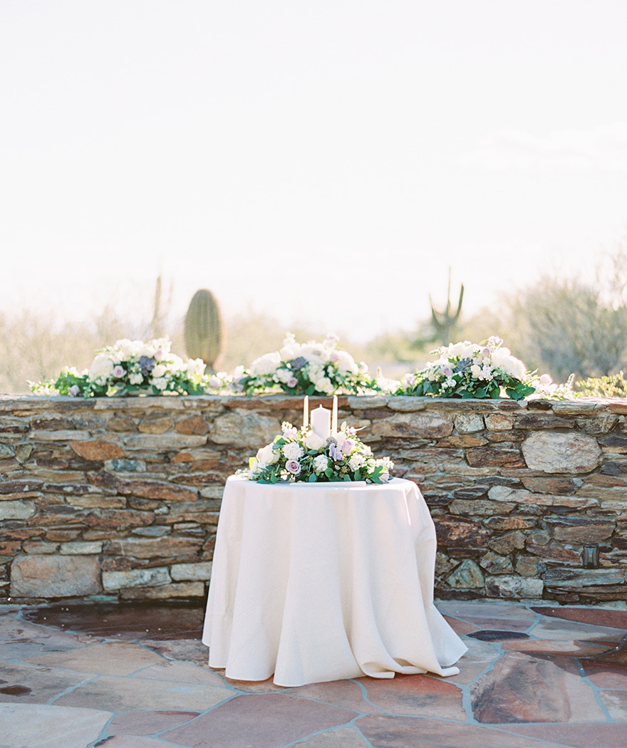 Outdoor wedding ceremony with pale purple flowers