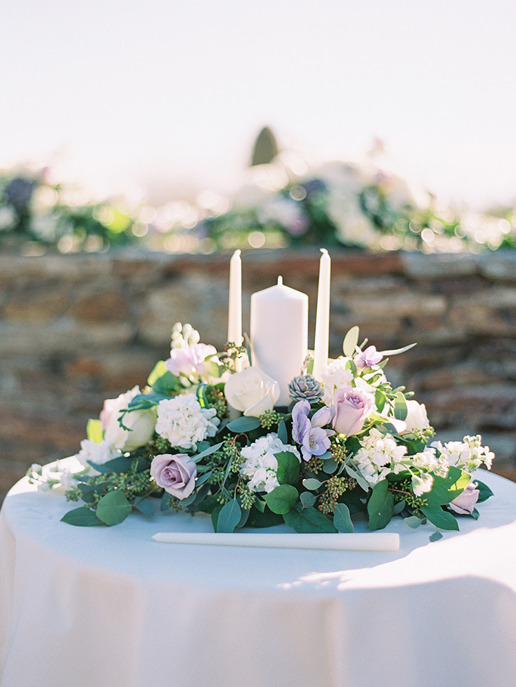 Unity candles and pale purple flowers, outdoor wedding ceremony