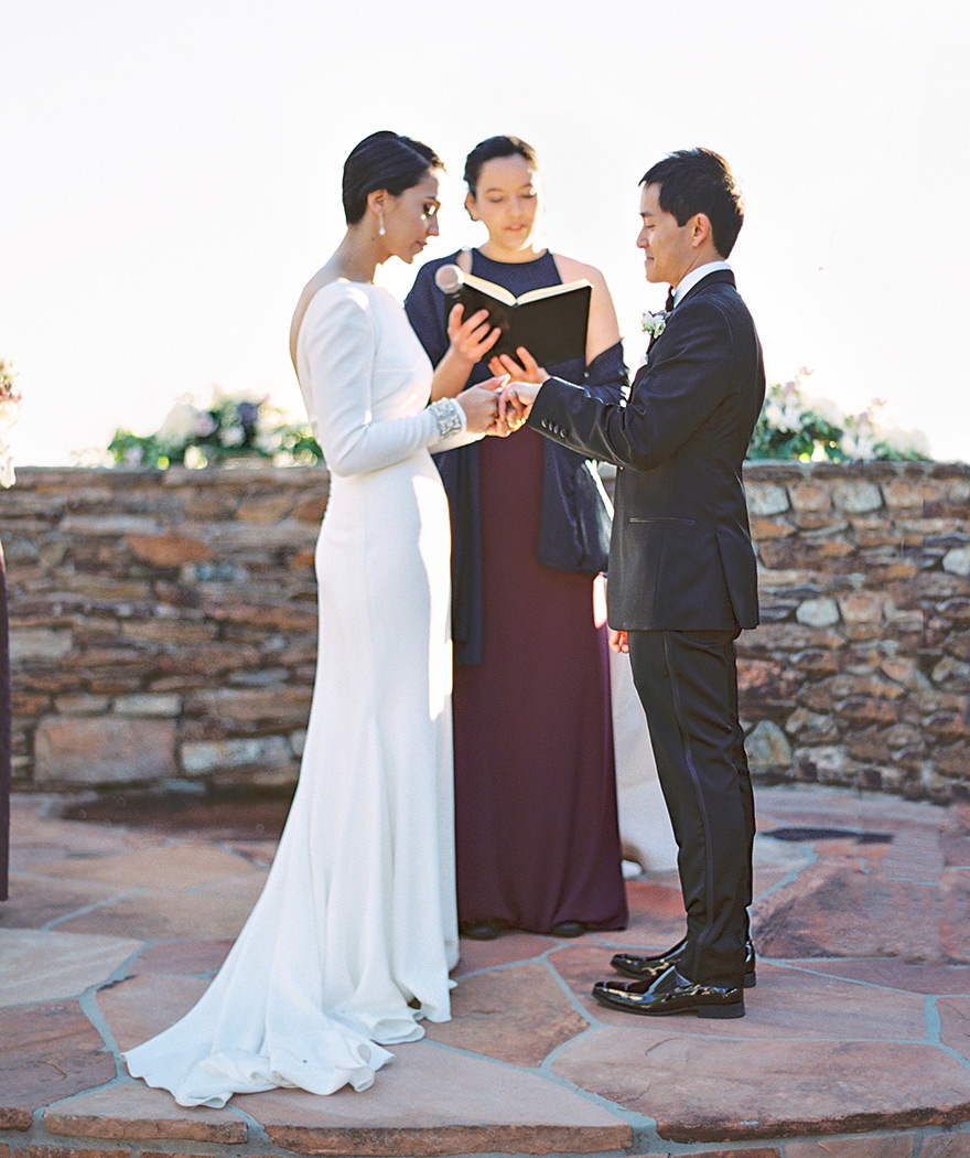 Exchanging rings, outdoor wedding ceremony