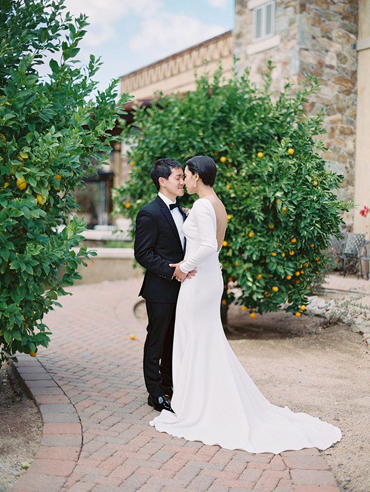 Stylish, modern bride & groom among the citrus trees