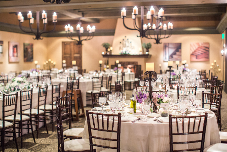 wedding reception at Sassi in Phoenix, decorated with candles and purple flowers