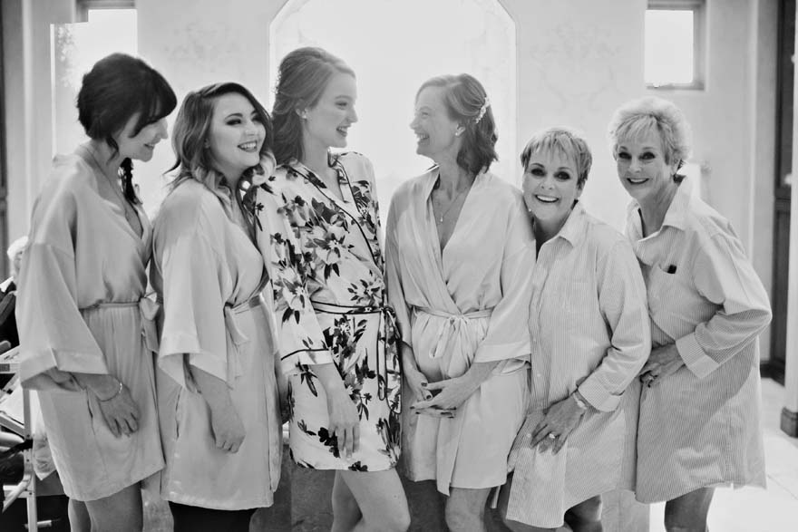 bridal party laughter in the getting ready room
