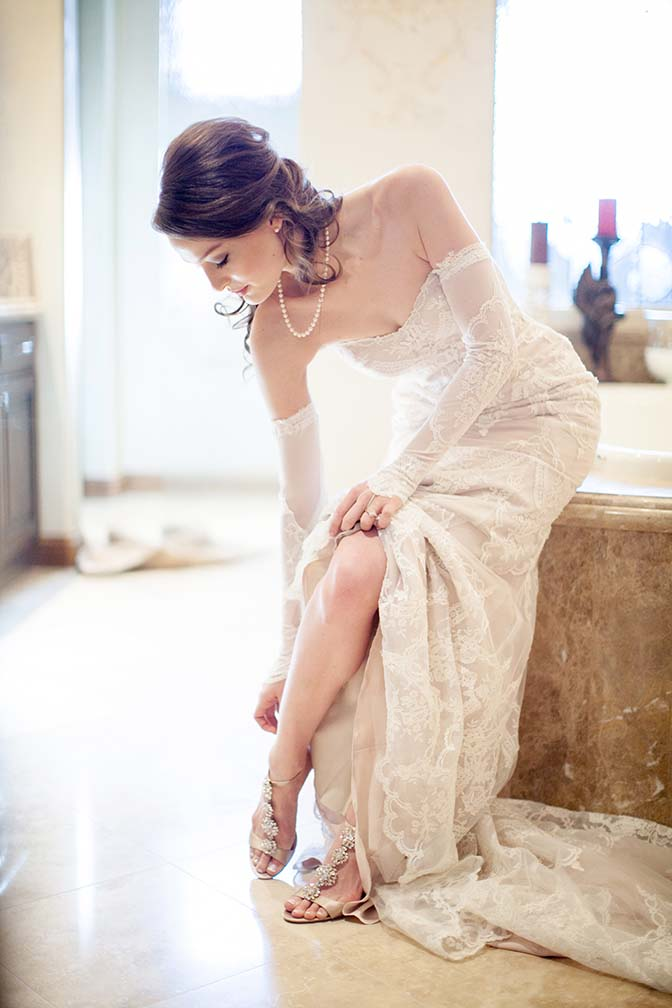 The bride adds her finishing touches, jeweled sandals