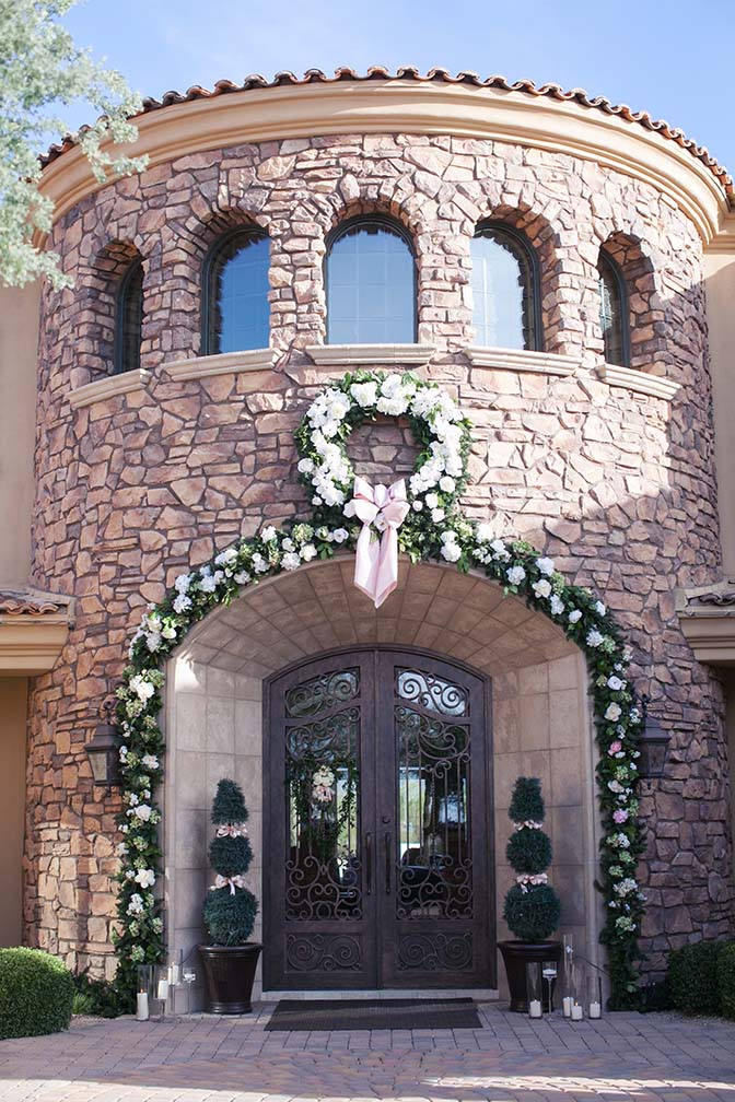 Front of the house decorated in flowers for a wedding