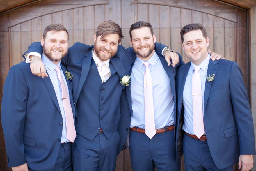 Groom & groomsmen in blue and pink