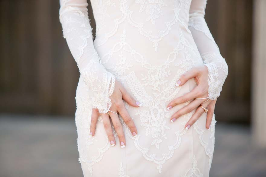 Strapless lace Maggie Sottero gown and fingerless lace gloves