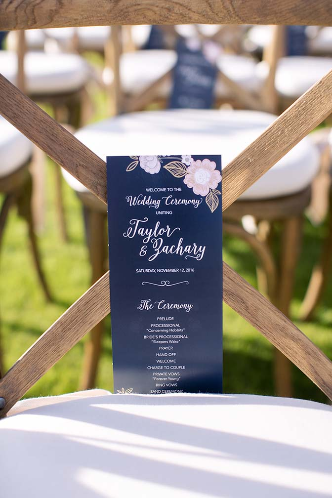 Wedding program on a wooden chair, outdoor ceremony