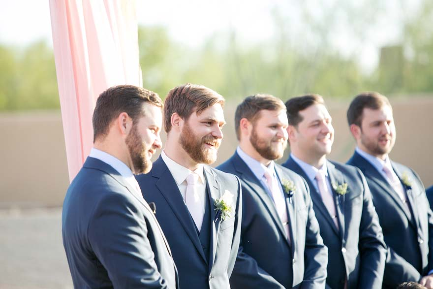 Groom & groomsmen await the bride