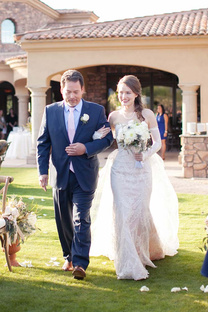 Father-of-the-bride walking the bride down the aisle