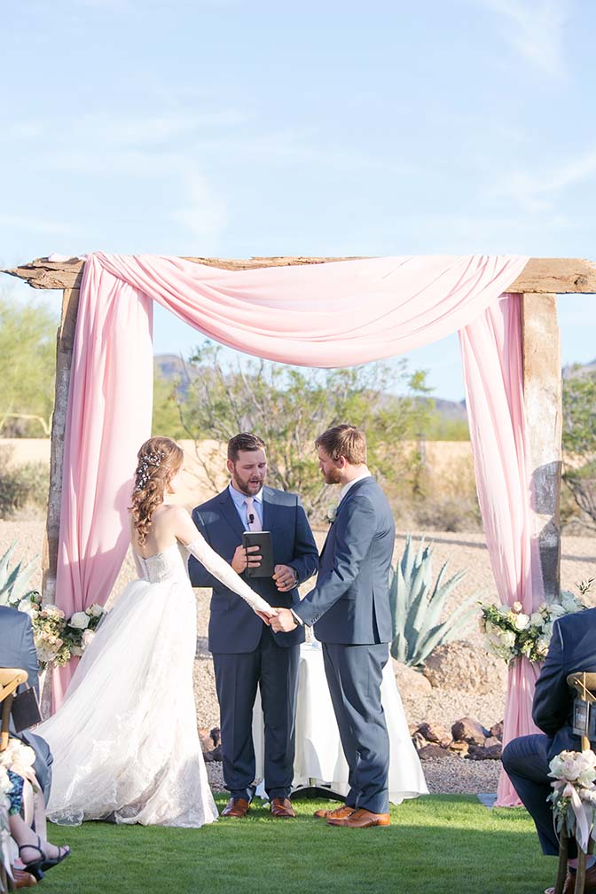 Exchanging vows in an outdoor wedding ceremony in Arizona