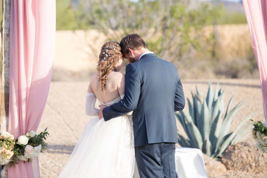 Private moment in an outdoor wedding ceremony in Arizona