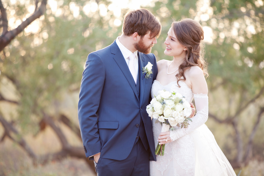 Groom in a blue suit, bride in strapless lace