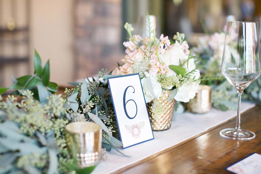 Gold and brass with dress flowers, outdoor wedding reception