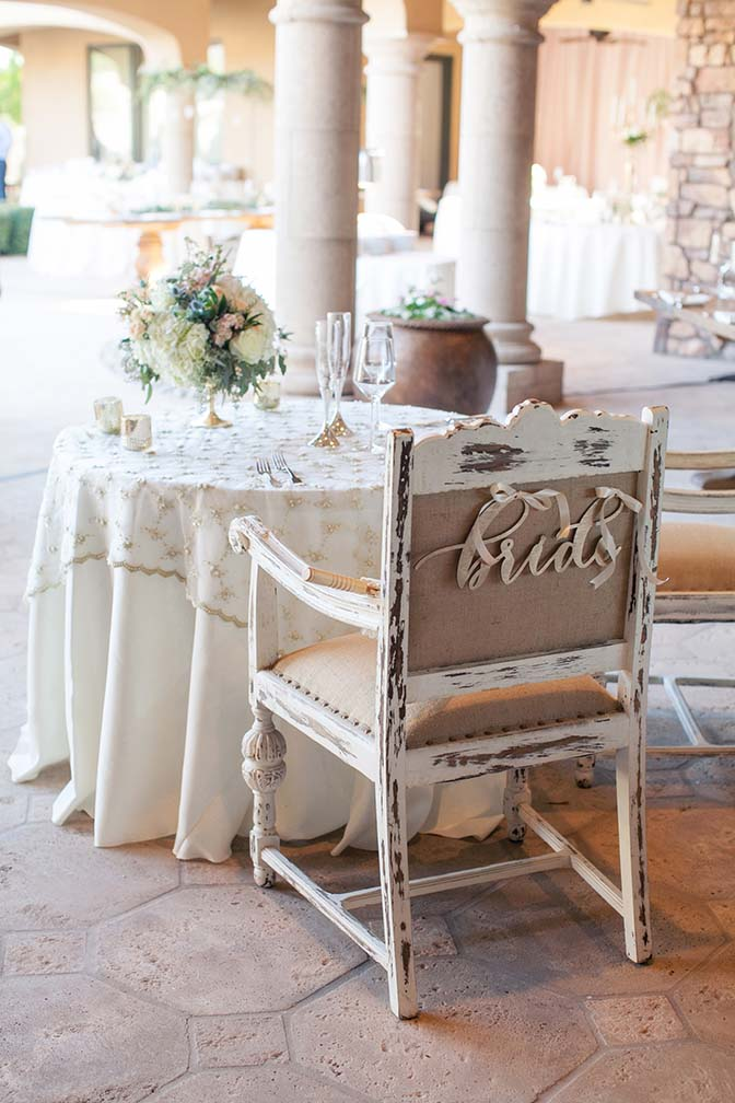 Rustic chairs and elegant details at the sweetheart table