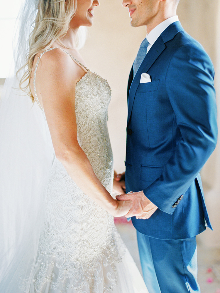 lace & tulle wedding gown for the bride, blue suit for the groom