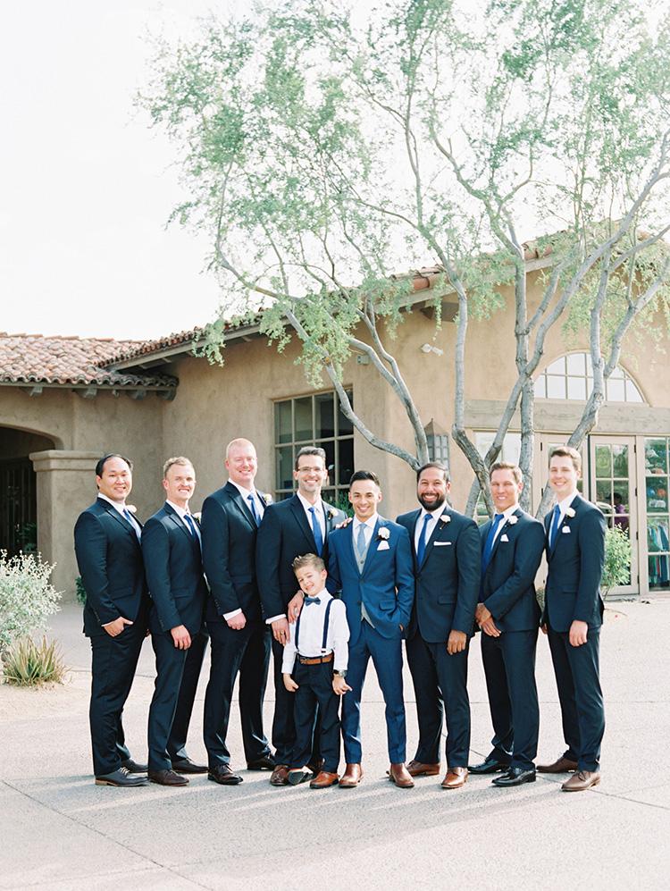 smiling groomsmen