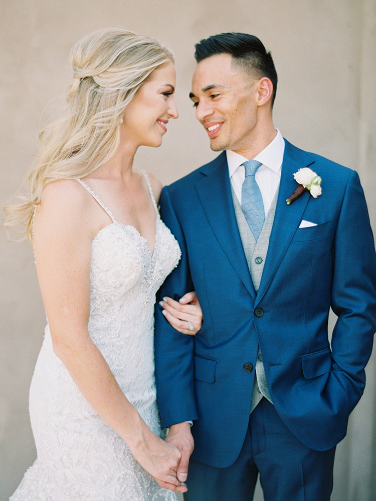 lace & tulle wedding gown for the bride, three-piece suit for the groom