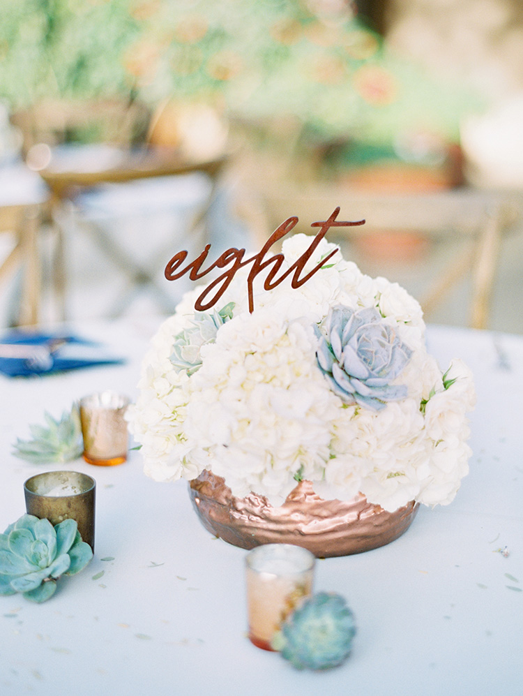 white flowers and succulents with metallic accents