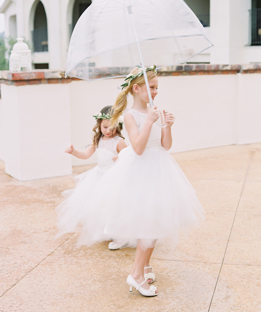 flower girls in the rain