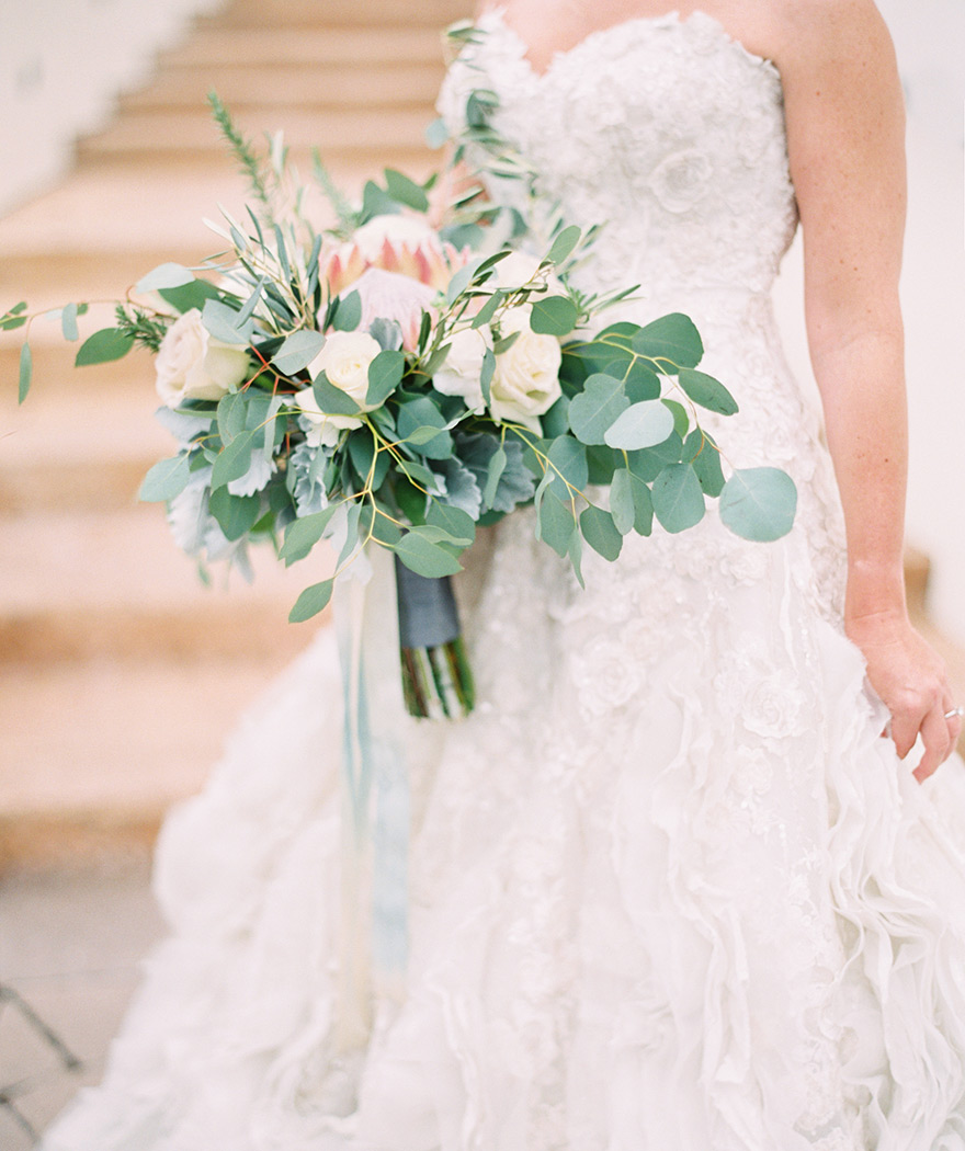 lace & tulle Ian Stuart gown and bouquet with protea