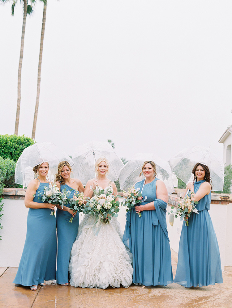 rainy day bridesmaids in blue