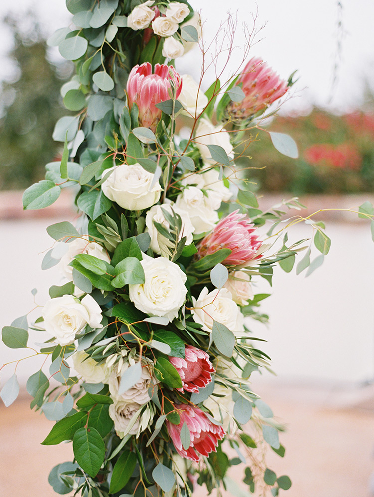 wedding arch with roses & protea