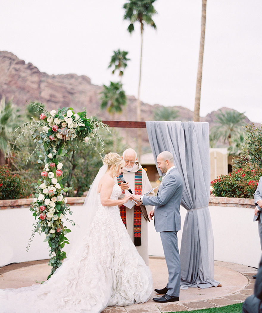 outdoor wedding ceremony with unique arch
