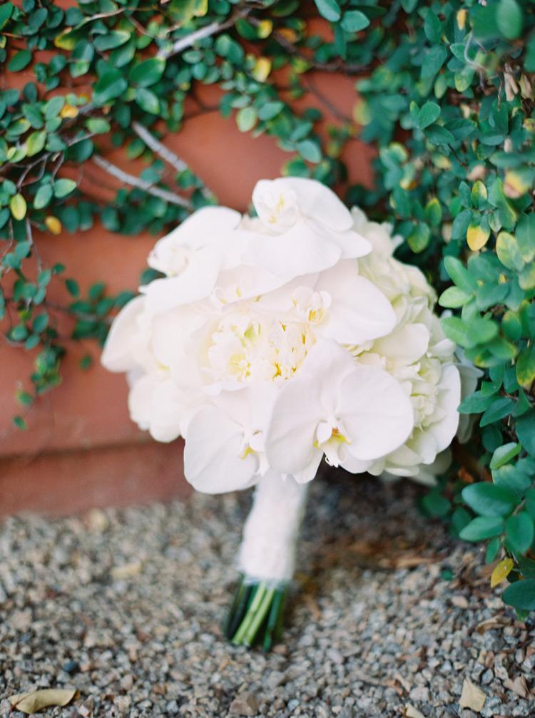 White orchids bouquet arrangements for outdoor wedding.