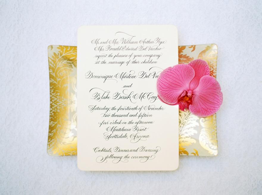 Elegant gold and orchid flower wedding invitation.