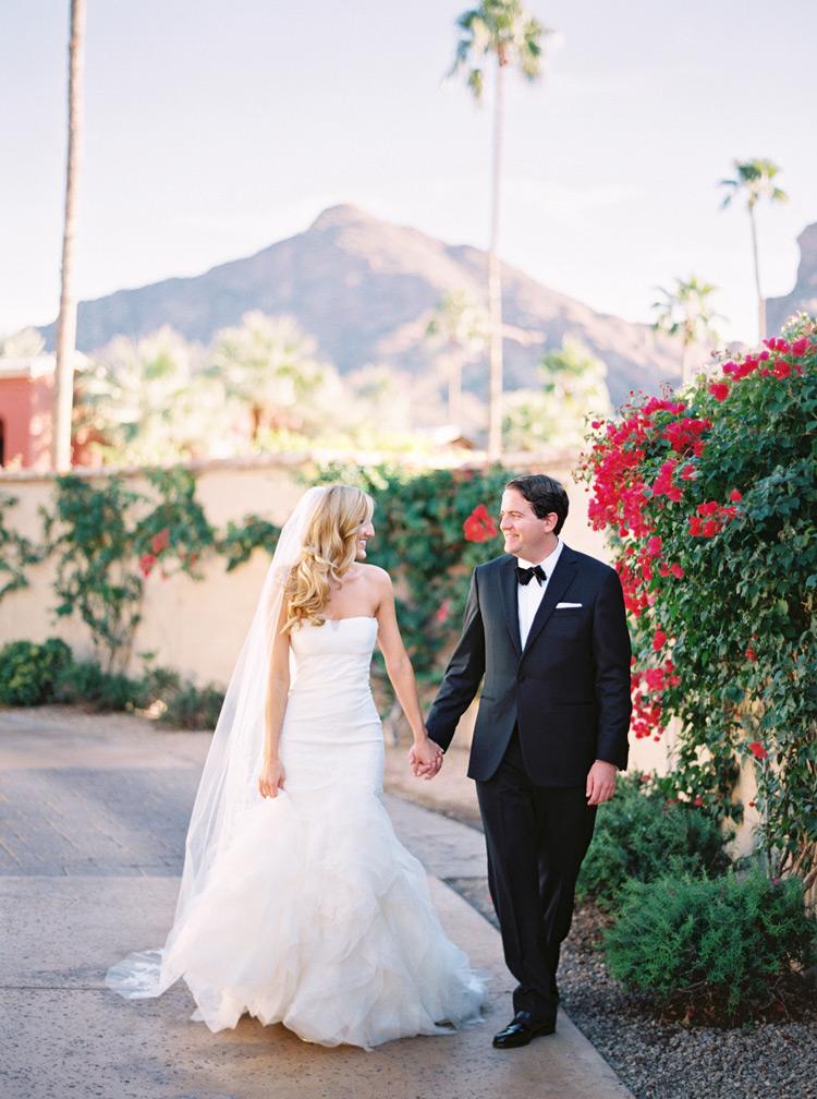 Bride and groom walk hand in hand during first-look shot. Omni Montelucia weddings.