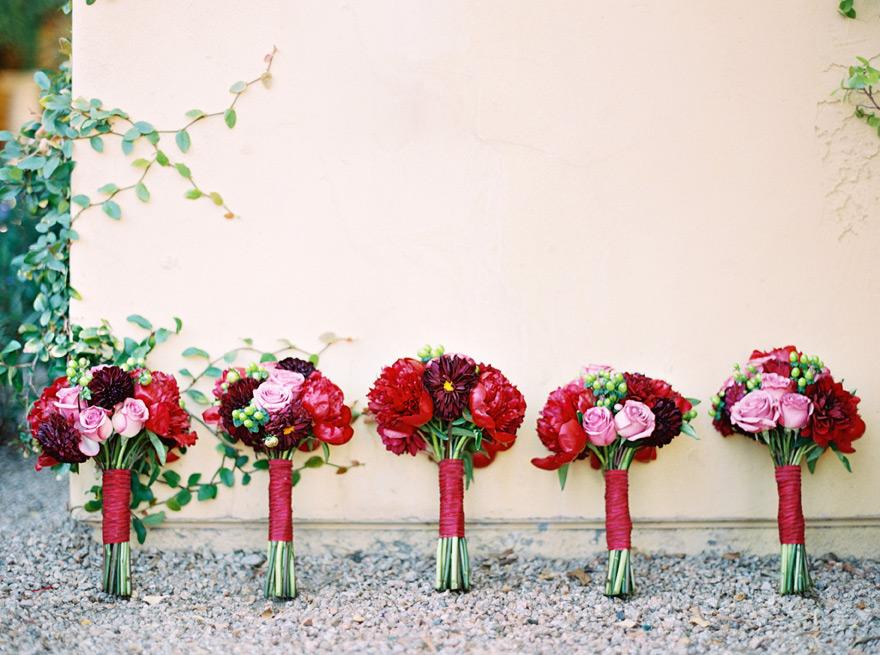 Deep colored bridesmaid bouquet arrangements.